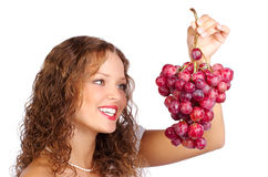Woman with grape Stock Photography