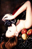 Woman and grape Stock Photography