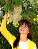 Woman with grape Royalty Free Stock Images