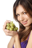 Woman with grape on white background Royalty Free Stock Images