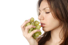 Woman with grape on white background Stock Photo