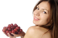 Woman with grape on white background Stock Image