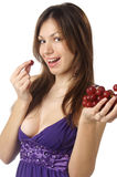 Woman with grape on white background Royalty Free Stock Image