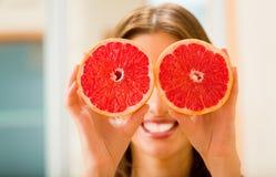 Woman with grapefruit Stock Photos