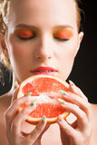 Woman with grapefruit Stock Image