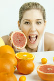 Woman with grapefruit Stock Photos