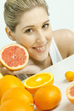 Woman with grapefruit Royalty Free Stock Images