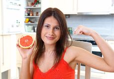 Woman with grapefruit. Young woman with red grapefruit Stock Image