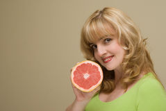 The woman with grapefruit in a hand Stock Image