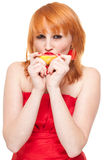 Woman with grapefruit isolated. Redhead attractive woman biting grapefruit Royalty Free Stock Photography