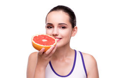 The woman with grapefruit isolated on white Stock Photography