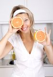 Woman with grapefruits Stock Images