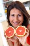 Woman with grapefruits Stock Photos