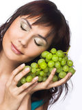 Woman with grapes. Portrait of young woman with green grapes Stock Photos