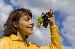 Woman with grapes Stock Photo