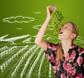 Woman with grapes Stock Photos