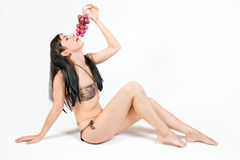 Woman with grapes Royalty Free Stock Photos