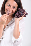 Woman with grapes Royalty Free Stock Image