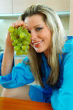 Woman with grapes Stock Images