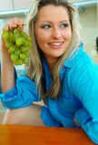 Woman with grapes Royalty Free Stock Photography