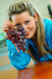 Woman with grapes Royalty Free Stock Images