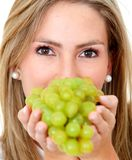 Woman with grapes isolated Stock Images