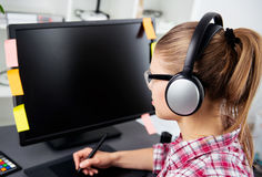 Woman graphic designer in headset Stock Photos