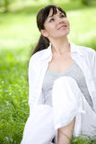 Woman on grass. Happy young woman relaxing on grass Stock Image
