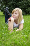 Woman on the grass. Beautiful young woman on the grass with apple stock photo