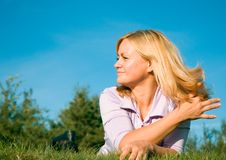 Woman on grass Stock Images