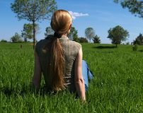 Woman in the grass. Woman relaxing in a green field Stock Photography