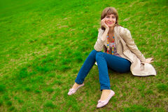 Woman on grass Stock Image