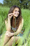 Woman in grass Stock Images