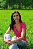 Woman on the grass Royalty Free Stock Images