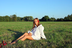 Woman on the grass Royalty Free Stock Photos