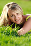 Woman in grass Stock Photography