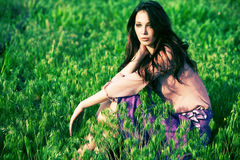Woman in grass Royalty Free Stock Images