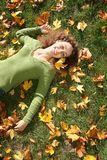 Woman on the grass Stock Image