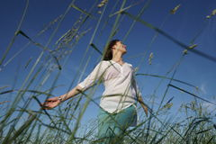 Woman in grass Royalty Free Stock Photo