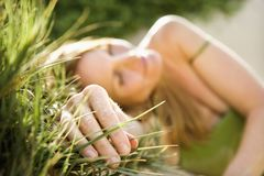 Woman in grass. Stock Image