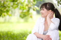 Woman on grass. Attractive brunette woman relaxing on grass Stock Photography