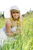 Woman in the grass. Beautiful woman in the grass royalty free stock photo