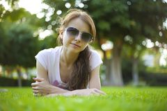 Woman on the grass Stock Images