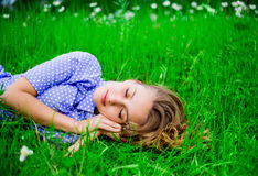 Woman on the grass Royalty Free Stock Photography