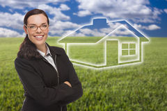 Woman and Grass Field with Ghosted House Figure Behind Stock Image