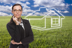 Woman and Grass Field with Ghosted House Figure Behind Royalty Free Stock Photos