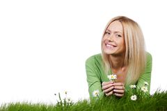 Woman on grass with flowers Stock Photos