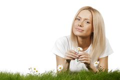 Woman on grass with flowers Royalty Free Stock Photography