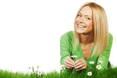 Woman on grass with flowers Stock Image