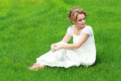 Woman on the grass Stock Photos
